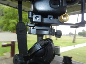 closeup of main setscrew to adjust rail (gold) and QR plate from baseplate to tripod mount