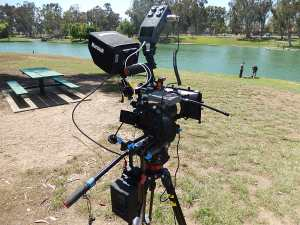Full cinema rig configuration with HDMI monitor, whip/follow focus, Zoom H6, AudioTechnica wireless lav system and rear brick battery with D -taps to camera, light, DAR or monitor