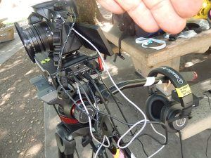 side view showing connections for digital audio recorder positioned below camera