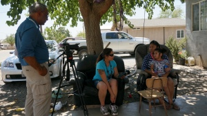 Melinda Steffen interviewing a resident dealing with acute water supply issues in East Porterville, CA
